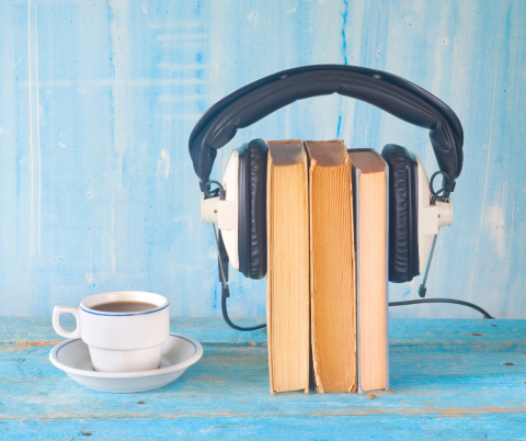 Book, headphones and coffee cup